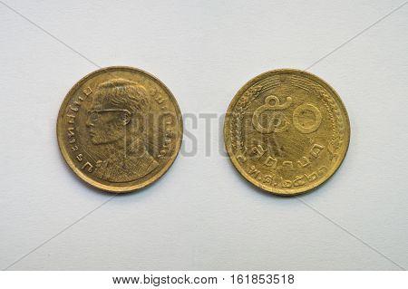 Old Thai coin on white background 50 satang B.E. 2523