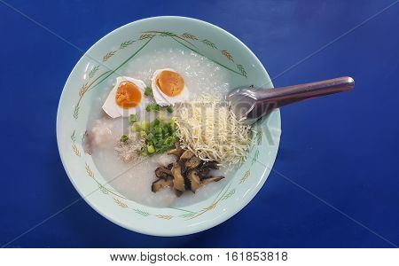 Minced Pork and salted egg traditional thai porridge rice gruel  in bowl. Thai Breakfast.