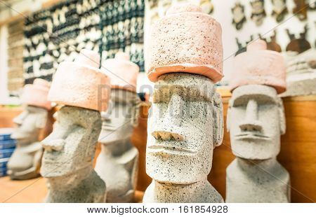 Small moai statues in generic souvenir shop from Eastern Island in Chile - Shallow depth of field with focus on the nose of biggest figure