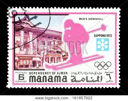 MANAMA - CIRCA 1971 : Cancelled postage stamp printed by Manama, that shows Downhill skiing.