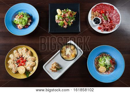Eatable perfection. Top view of a variety of tasty dishes served at the restaurant