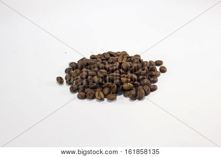 Hill fragrant fried coffee beans on white background