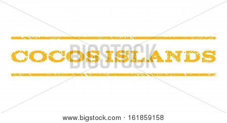 Cocos Islands watermark stamp. Text tag between horizontal parallel lines with grunge design style. Rubber seal stamp with scratched texture. Vector yellow color ink imprint on a white background.