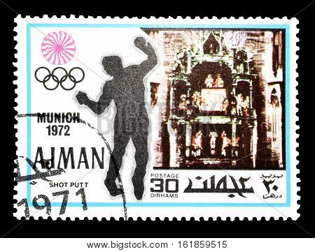 AJMAN - CIRCA 1971 : Cancelled postage stamp printed by Ajman, that shows Shot putt.