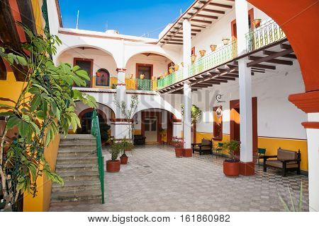 OAXACA, MEXICO-DEC 10, 2015: Art of traditional house with indoor jard in Oaxaca on Dec 10, 2015, Mexico.