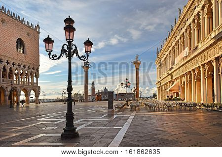 Piazzetta San Marco with granite columns Lion of St Mark and St Theodore in Venice, early in the morning before the invasion of tourists