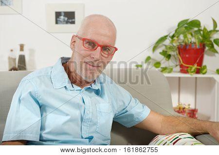 portrait of a handsome mature man with a shirt blue