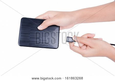 woman hand put USB cable into external hard disk isolated on white background