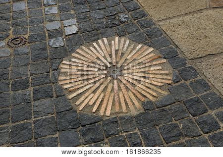 Closeup of pavement with concentric pattern. Patterned floor walkway in the park Montjuic Barcelona Spain.