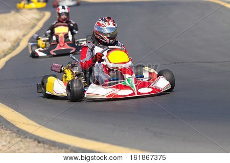 Adult Go Kart Racers on Track entering corner