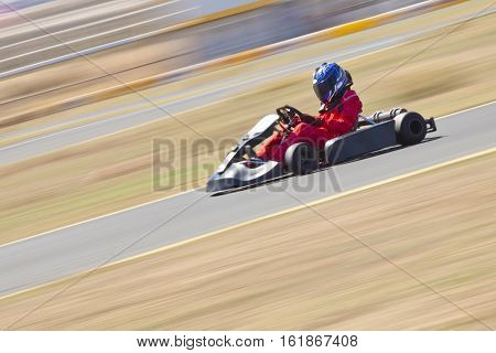 Youth Go Kart Racer on outdoor track