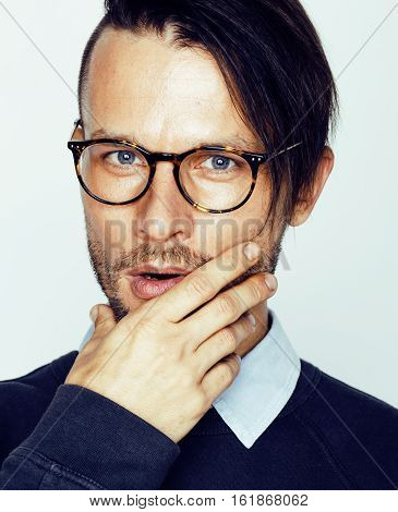 handsome middle age hipster man with modern hairstyle and tattoo, beard, close up on white background real