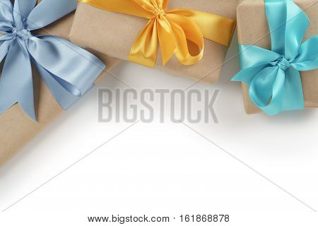 rustic gift boxes with ribbons on white background, border background for holidays