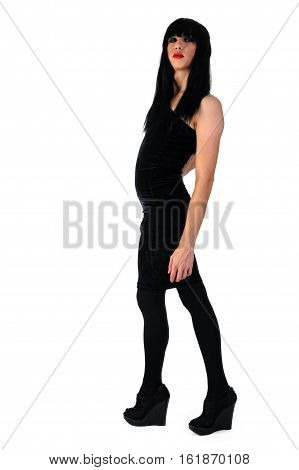 Cute transvestite man dressed as woman stands over white background