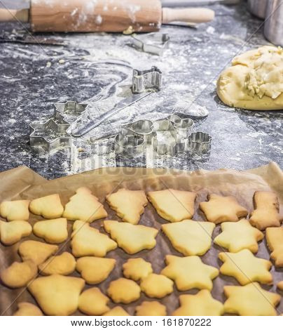 Baking cookies for Christmas. Christmas and holiday baking background, flour, bakeware and shapes for cookies.