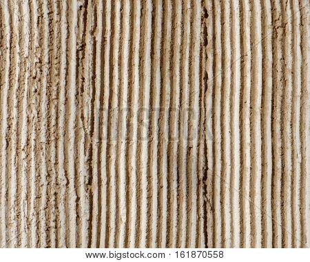 linear light brown rough plaster closeup pattern