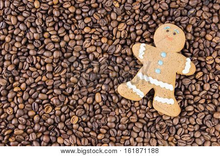 Coffee beans on wooden background are on the table top view. The concept gingerbread