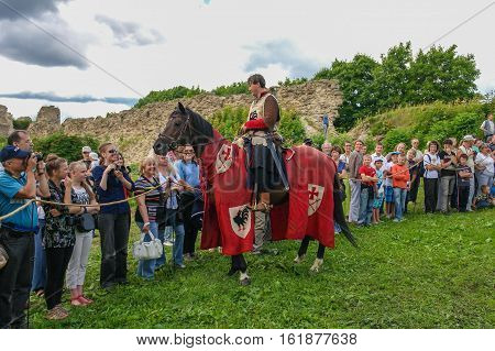 Koporje, Leningrad region, Russia - July 21, 2012: Reconstruction of knightly duels and battle chivalrous life camp, tents. Equestrian Knight welcomes visitors.