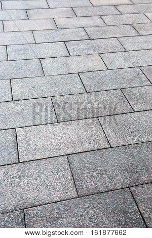 large granite slabs on the sidewalk, vertical image