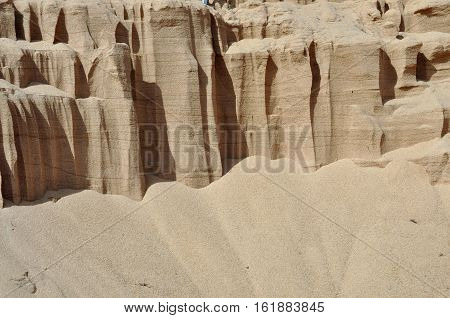 Background of quartz sand the river bank.