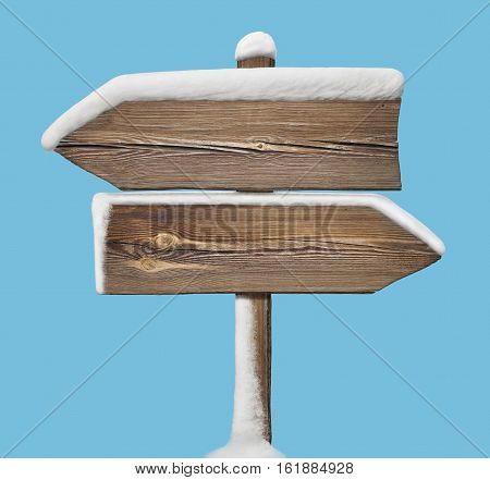 Wooden Direction Sign With Less Snow On Blue. Two_arrows-opposite_directions