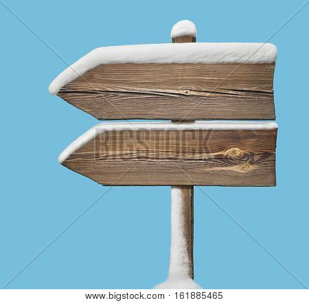 Wooden Direction Sign With Less Snow On Blue. Two_arrows-one_direction