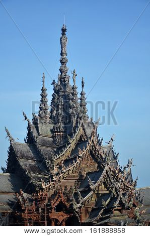 PATTAYA THAILAND - 20 NOV 2016: Sanctuary of Truth located in Pattaya. Sanctuary of Truth is an all-wood building filled with sculptures based on traditional Buddhist and Hindu motifs.