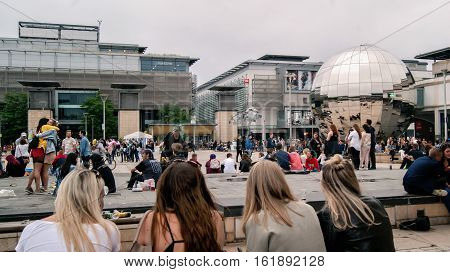 Bristol UK - July 16 2016: crowds of people enjoying the water feature of Millennium Square at the annual Harbour Festival in Bristol UK