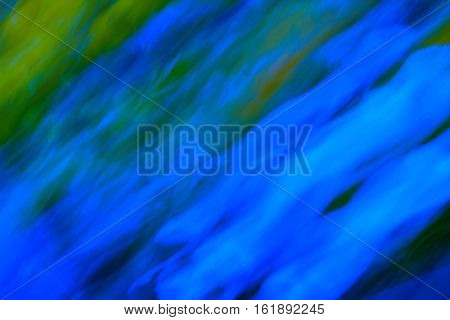 Abstraction: Streams of neon blue light pouring into a green meadow.
