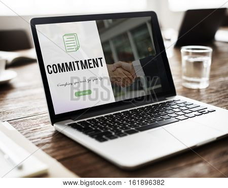 Commitment word on business handshake background
