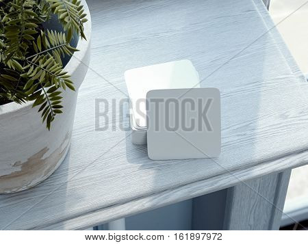 Stack of white square beer coasters on wooden windowsill. 3d rendering