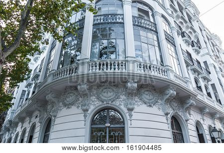 Building detail.  Generic architecture in Barcelona,  European style with updated traditional glass features.