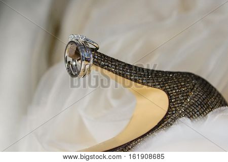 wedding rings for women's shoes close up of wedding rings on bride's shoes