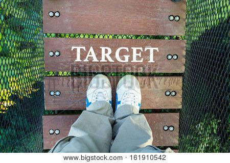 Target And Man Leg On Wood Canopy Walk Way