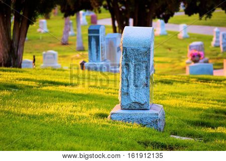 Vintage cemetery with old headstones surrounded by a manicured lawn