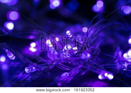 Christmas garland in purple color. Selective focus.