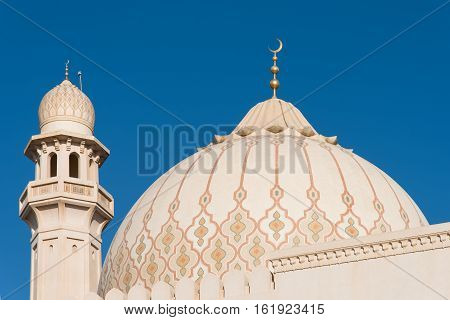 The dome and one of the minarets of the Sultan Qaboos Grand Mosque in Salalah Dhofar Region of Oman.