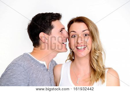 Man Whisper In The Ear Of His Girlfriend