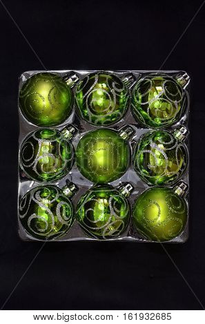 decorations for Christmas trees square package for green glass balls on a black background