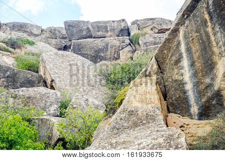 Ancient petroglyph drawings on the rocks in Gobustan Azerbaijan