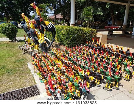 SUPHANBURI THAILAND - NOVEMBER 27 : Chickens statue for get rid of the unfortunate according of the faith of the Thai's people on November 27 2016 in Suphanburi Thailand.