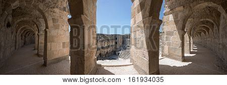 Aspendos panoramic photo. Stone arch gallery surrounding scene and seats. Aspendos is the best-preserved theatre of antiquity in Turkey.