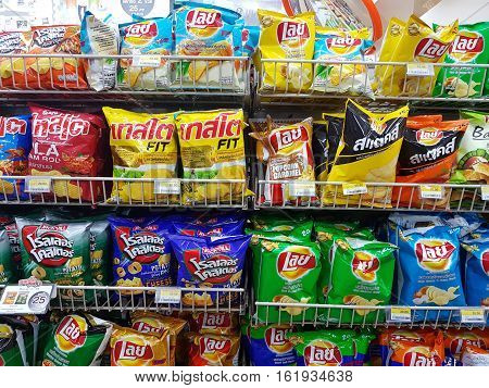 CHIANG RAI THAILAND - NOVEMBER 28: various brand of Potato chips in packaging for sale on supermarket stand or shelf in Seven Eleven on November 28 2016 in Chiang rai Thailand