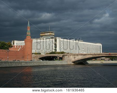 Kind on hotel Russia and an angular tower of the Moscow Kremlin through the Moskva River before a thunder-storm.