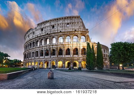 Colosseum in Rome at sunset with lights Italy