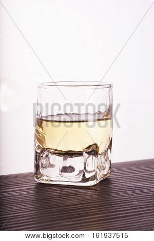 Glass Of Whisky Over White