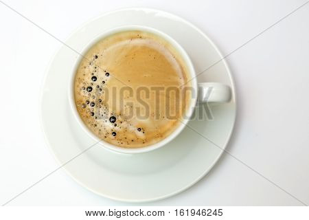 white cup with espresso coffee isolated on white.