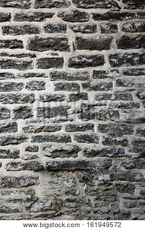 old wall made of grey stones and cement