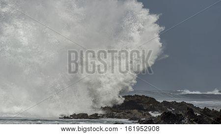 Massive Wave Breaks On Rocks