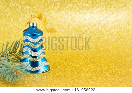 Blue Christmas Bell On Yellow